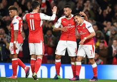 Goalscorer Sanchez is congratulated by Francis Coquelin (second right) and Mesut Ozil after handing Arsenal an early lead