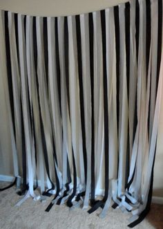 DIY New Year's Eve party backdrop using crepe paper streamers. aperrymanparty.com