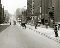 Locust Street looking west from Seventeenth Street. Union Electric substation on right, Butler Brothers Store on left. (1910) Missouri History Museum