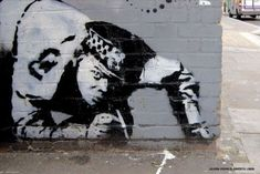 Graffiti tags can be words and images but this guy uses social commentary as his signature. #banksy #graffiti