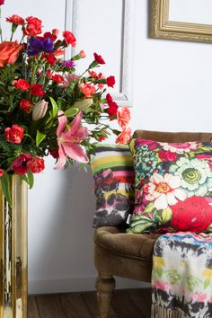 Say it with flowers! If you don't have any fresh flower arrangements, then our floral cushions and bedding will also do the trick.