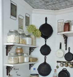Don't hide your cast iron skillets - use them as wall art!  ~~~via http://knickoftimeinteriors.blogspot.com/