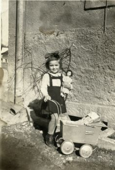 "Miriam Steiner plays with her doll shortly before her arrest, She was sent to Stara Gradiska concentration camp. Later, she and her family joined Italian partisans. Her book, ""Soldier with Golden Buttons"" is used to teach a child's point-of-view of the war. Steiner has evaluated candidates for the honor of Righteous of All Nations and volunteered at the Even Yom Tov Archive of Yugoslavian Jewry."