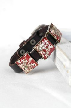 Red leather bracelet with real flowers. Little piece of art that you can wear.  Total length: 6,5/8,5 inch (17/21 cm). Width: 0.4 inch (10 mm). Size