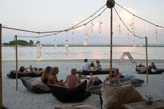 Chill Chill on bean bags on the beach at Mini Bar, Chaweng Beach, Koh Samui, Thailand.