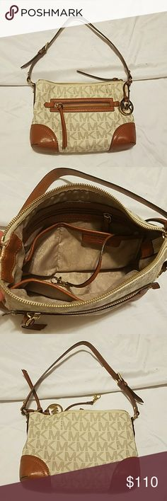"""Authentic Michael kors bag. Michael kors bag.Size small to medium.8""""H and 11"""" W.Used small wear seen on the pictures other than that in a good condition. Michael Kors Bags"""