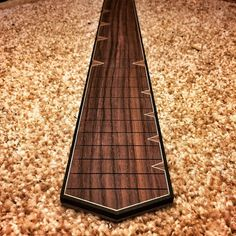 Rosewood fretboard with ebony binding and cool zigging and zagging maple purfling. Custom Bass Guitar, Custom Electric Guitars, Guitar Diy, Custom Guitars, Cool Guitar, Acoustic Guitar, Guitar Inlay, Guitar Neck, Cigar Box Guitar