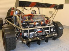 The MEV rocket. An exoskeletal kit car, similar to an Ariel Atom. This is probably the best of the breed. Much of it is carbon for even more weight saving, and it is powered by a supercharged 2.0 zetec giving just over 300bhp in a car weing 545kgs!!