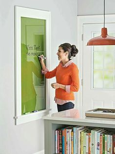 Coloured glass in place of a chalk board..a more attractive alternative.