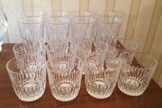 """Princess House crystal, glass bar and beverage pcs, featuring 8""""diam x 10""""H P.H. handled pitcher and set/8 vintg shrimp cups 5.5""""H ea. Also incl set/8 bar high ball glasses 5.5""""diam ea; set/8 bar low ball glasses 3/75""""diam ea; set/4 champaign flutes 10""""H ea; set/8 tall wine glasses 8""""H ea; P.H. S&P set; plus assort of bar glasses in basement incl sets of 12, 8,8,6 & 2."""