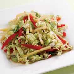 Asian Cabbage Slaw: 3 tablespoons rice vinegar, 1 tablespoon reduced-sodium soy sauce, 1 tablespoon toasted sesame oil, 1 teaspoon grated fresh ginger, 1/4 teaspoon ground white pepper, 1/4 teaspoon crushed red pepper, or to taste, 3 cups shredded napa or green cabbage, 1 cup thinly sliced red bell pepper, 1/3 cup sliced scallions, 1 8-ounce can bamboo shoots, drained and thinly sliced