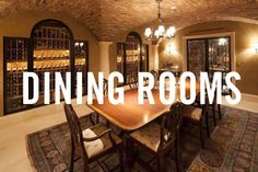 The Old Disney Estate in Holmby Hills has tile flooring, colorful area rug, groin-vaulted ceilings, exposed brick, ornate wine cellar and hanging light fixture.