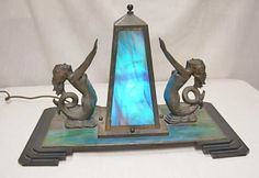 An art deco lamp blog http://www.artdecolamps.com/2008/11/dual-mermaid-slag-glass-lamp.html