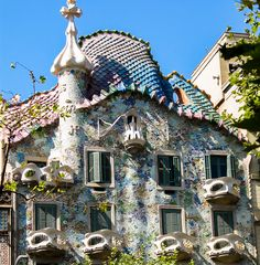 The colorful facade of the apartment building by A original. Gaudi, Facade, Places To Go, Barcelona, Explore, The Originals, Building, Colorful, Beautiful