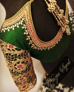 Make the cut in Emerald and gold ! Stunning green color designer blouse with hand embroidery gold thread and kundan work on neck line. Flower design sleeves with cut work. Gold ball tassels give more attractive look. Fancy Blouse Designs, Bridal Blouse Designs, Blouse Neck Designs, Cut Work Blouse, Maggam Work Designs, Designer Blouse Patterns, Blouse Models, Malu, January 2018
