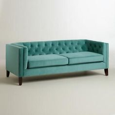 Love this color teal/mint/sage... too bad it only has 3 stars (also not into the tufted look). I wonder if there's a good navy sofa I can get. Seems like I see very few sofas in a dark blue. Also would consider a neutral brown sofa.   Teal Velvet Kendall Sofa