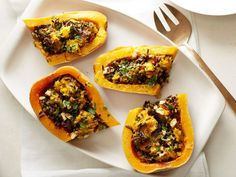 Vegan Wild-Rice-Stuffed Butternut Squash : This impressive autumn-inspired dish can be served as a main course for vegan and vegetarian eaters, or it can be enjoyed by everyone at the table as a side dish. The small amount of curry powder gives the squash a nice warmth and depth.