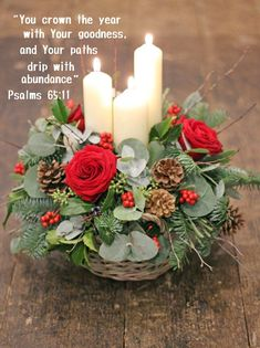Candle & Fresh Flower basket arrangement ~ Rich Reds Decorate your home with this beautiful festive candle table decoration. A scented mixture of fresh Christmas foliages and red roses and berries, with white chapel candles in a wicker basket. Christmas Flower Decorations, Christmas Flower Arrangements, Christmas Table Centerpieces, Christmas Flowers, Christmas Candles, Christmas Wreaths, Christmas Crafts, Xmas, Winter Flowers
