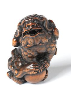 A large wood netsuke of a shishi Kyoto, late century