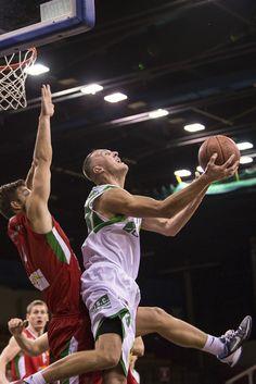 Przemysław Lewandowski (right, with ball) in reverse layup making two points for Znicz. http://piotrkoperski.pl/index.php/pierwszy-znicz/