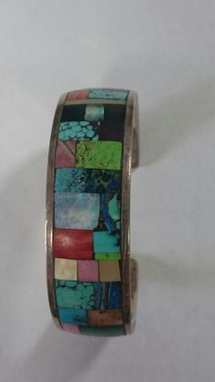 Sterling silver cuff bracelet with multicolored gemstone inlay...my paintbox bracelet! Crafted by Rick Bradshaw, Las Cruces, NM #southwest art #southwest jewelry #turquoise jewelry