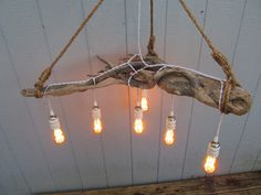 Driftwood Light - Custom made light fixture from Bud's Lights.  Made with reclaimed driftwood, vintage style edison bulbs and knotted rope.