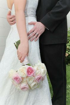 Bridal bouquet - cream roses with soft pink garden roses wrapped in soft pink satin ribbon and lace. Flowers by Allison Enzenbacher https://www.facebook.com/weddingflowersbyallison Photo by Abigail Rachel Photography https://www.facebook.com/pages/Abigail-Rachel-Photography/78827885020