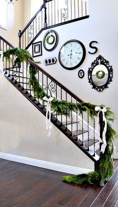 Beautiful fresh garland going up the stair rails for Christmas, so pretty!
