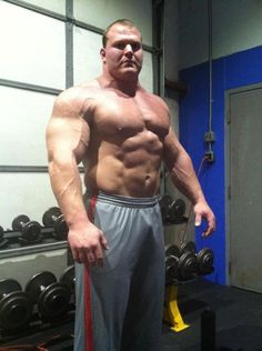 """Strongman Derek Poundstone - Height: 185 cm / 6' 1"""" - Weight: 155 kg / 341 lbs  .......and a six pack!"""