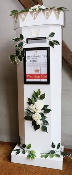 DIY Wedding post box made from white cardboard and simply decorated with foam and plastic flowers and foliage (glued). Frame attached to the front allowed me to put an A4 picture or wedding logo on the front to suit my wedding theme. Completely adaptable for anyone's wedding. Diy Wedding Post Box, Wedding Ideas, Wedding Logos, Wedding Invitations, Cranberry Color, Plastic Flowers, Rustic Theme, Save The Date, A4