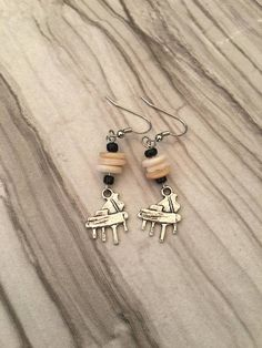 Love to tickle the ivory keys? Youre going to love these baby grand piano earrings. I added some ivory looking flat beads and some black seed beads to represent the keys. I love to make things YOURS. If you have an idea you need to bring to life, message me! I am happy to work with you to make any item perfect. I have many,many charms from animals to hobbies so if you can think of it, I can make it. You will only pay shipping on the first jewelry item. This is to ensure tracking. The rest of…