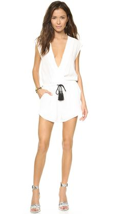 A lustrous tassel cinches the loose silhouette of this romper, styled with a crossover V neckline. Slant hip pockets. Lined shorts. #ShopBop