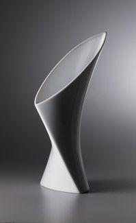 http://www.archithings.com/wp-content/uploads/2011/10/Nambe-The-Torso-Vase.jpg