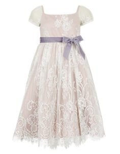 Evoke a romantic, vintage feel with the Damsel lace dress for girls. Overlaid in bridal lace, it features cap sleeves, a lilac velvet sash bow and a scalloped lace hem. The rose pink duchess satin lining not only looks beautiful but gives a great shape.