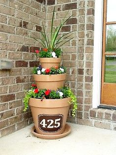 address flower tower-This would be great on corners of patio planted with mosquito repelling plants!