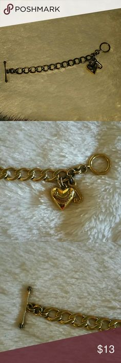 """Juicy Couture Charm Bracelet Gold tone charm bracelet by Juicy Couture. Includes two charms. You can also add charms of your own =). Very good pre owned condition!!! 7"""" long Juicy Couture Jewelry Bracelets"""