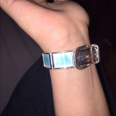 Bracelet Blue all around and looks like a belt buckle at clasp. Jewelry Bracelets