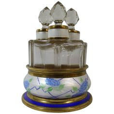 Birks Art Deco Perfume Bottle Set and Holder with Enameled Design | From a unique collection of antique and modern vases and vessels at https://www.1stdibs.com/furniture/decorative-objects/vases-vessels/