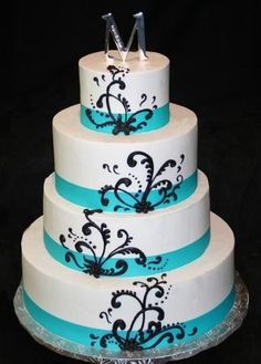 blue wedding cake with orange stencelling