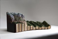 Another batch of carved books by Montréal-based artist Guy Laramée (click herefor previous posts). See more incredibly detailed landscapes below!                Guy Laramée's Website