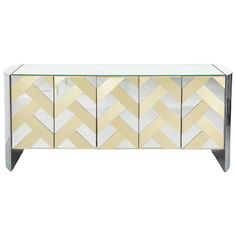 Ello Mirrored Credenza   From a unique collection of antique and modern credenzas at https://www.1stdibs.com/furniture/storage-case-pieces/credenzas/
