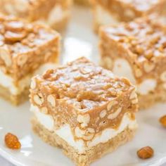 If you happen to get a mighty craving for a peanut treat in the middle of the day and dipping a spoon in a jar of peanut butter just won't do, don't fret. You can easily make these chewy peanut squares in a jiffy. This treat consists of three layers of goodness – a peanut butter shortbread layer, a puffy marshmallow layer, and a salty-sweet and crunchy topping. Peanut craving solved.