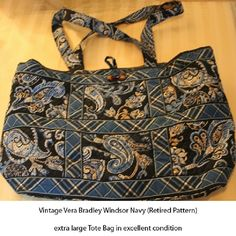"""LOWER PRICE! Lg Vera Bradley Tote, Windsor Navy Extra lg Vera Bradley Tote in blue/navy paisley & plaid retired WINDSOR NAVY (2006-2008). Has 2 slip pockets inside front with wide zipped pocket inside back. 14""""x12""""x4"""" with 11"""" strap drop. Works well as purse but ideal for long-haul when you have lots of important stuff to """"tote"""" along. Wide straps make for easy shoulder carry. EUC from SFPF home. ***PLS SEE MY VERA LISTINGS IN THIS & OTHER RETIRED PATTERNS*** Vera Bradley Bags Totes"""