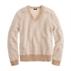 J crew cotton V-neck sweater The sweater is super soft and comfortable and ready for your favorite weekend outfit. Cream and tan stripes make this work with everything from khakis to jeans to everything in between. This is a generous size medium. 19 inch bust, 24 inch length. Excellent condition with no picks or pulls. J. Crew Sweaters V-Necks