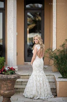 Lace wedding gown with keyhole back. Monique Lhuillier mermaid / trumpet dress.