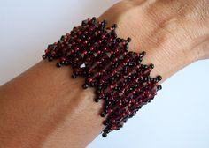 Learn to make a beaded cuff that will be the center of attention! Sparkling bicones hug the contours of your wrist creating a sturdy, superiorly attractive bracelet.  Like this design? Try the matching necklace: https://www.etsy.com/listing/77233640/bead-pattern-netted-crystal-bicone-tiara?ref=shop_home_active_4  Netted stitch is simple to learn, but the results are spectacular! The pattern uses a method that is fun and versatile. You will want to use it again an...