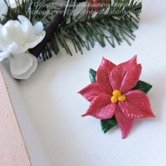 """Looking for something fun and festive?  This handmade brooch is made from polymer clay and hand painted with acrylic paint.  It will look great with many types and colours of clothing.      DESCRIPTION: It is approximate 1 1/2"""" by 1 1/2"""" x 3/4"""" inch and weighs 7 to 9 grams.    Each one is individually handmade so they will each be unique.  Materials: Polymer clay, acrylic paint, and a brooch pin.  Check out my website for more info by clicking on the photo.   Price is under $25.00!"""