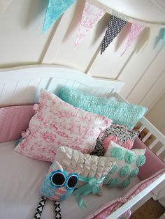 Cuteness in a crib...the love colors