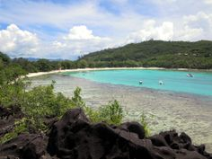 Port Launay Beach at the west end of Mahe Island, Seychelles, offers excellent snorkeling along the edge of the fringing reef.