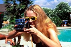 """Heather Graham as Roller Girl in Boogie Nights. The Look:  A porn starlet with a polaroid camera and roller skates.  The Quote:  """"I never take my skates off.""""..."""